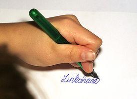 Zurdo escribiendo